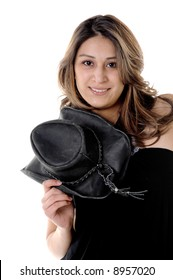 Pretty young Mexican woman in a black blouse and black leather cowboy hat