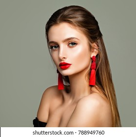 Pretty Young Model with Makeup, Long Brown Hair and Jewelry Earrings. Beautiful Model, Cute Female Face