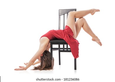 pretty young modern dancing woman sitting on the chair. Isolated on white