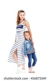 pretty young mom and cute daughter in striped clothing. isolated on white background