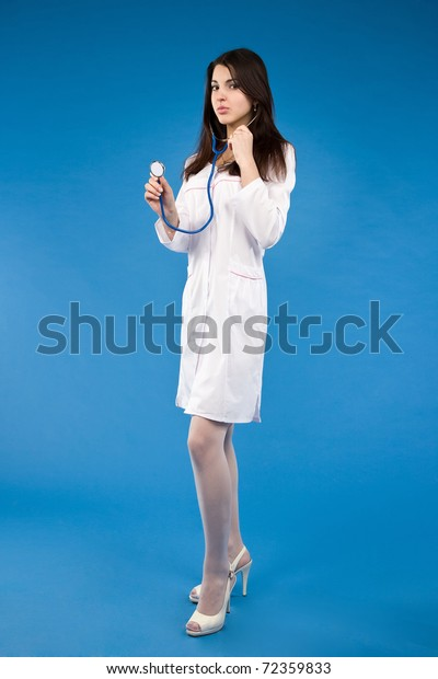Young Nurse Holding Medical Report And Stethoscope Stock