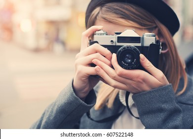Pretty young photographer taking a shot