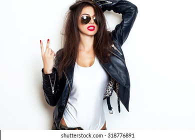 Pretty young sexy fashion sensual woman posing on white wall background dressed in hipster style jeans outfit,Stylish fashionable blonde girl hipster in black clothes.White background,not isolated