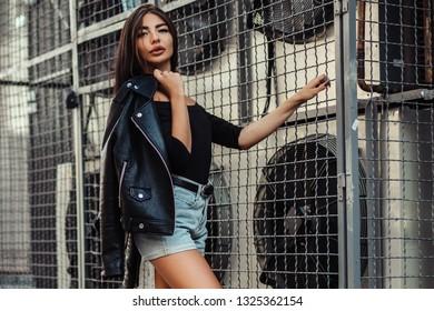 Pretty young sexy fashion woman posing on  ventilators background.