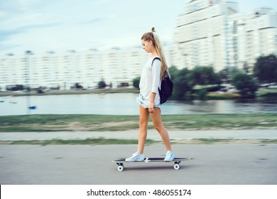 Pretty young sexy fashion woman walking alone with wooden longboard sensual outdoor portrait of hipster style sport girl in sunglasses summer bikini beach style