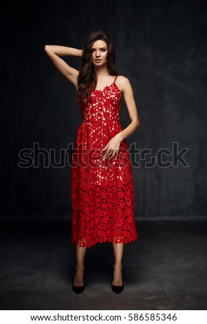 de28636754 Pretty young sexy model female with dark hair in amazing long red lace dress  and black