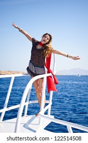 Pretty young slim  woman in  sailboat yacht on private speed-boat on vacation in summer time happy sailing in Mediterranean sea with red