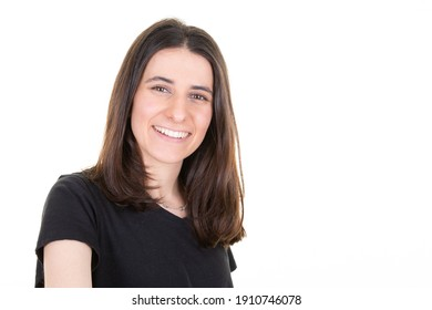 pretty young smiling woman poses against white background with blank copy space