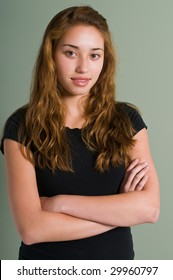 Pretty young teen in a black blouse