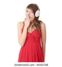 Pretty young teen girl wearing red dress and white earmuff, isolated on white