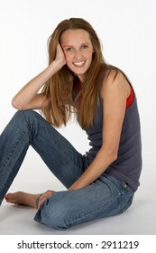 Pretty Young Teen in Jeans and Tank Top Leaning on Hand