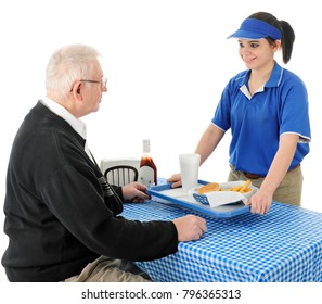 A pretty young waitress happily serving fast food to a senior adult man.  Focus on teen.  On a white background.