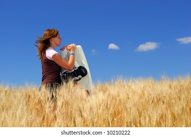 Pretty young wake boarder in Durum Wheat field, dreaming of water.