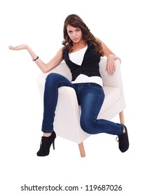 Pretty young woman in armchair posing to camera