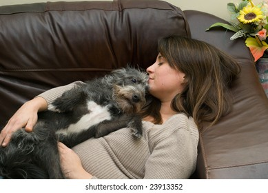 a pretty young woman asleep with her scruffy dog
