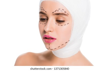 pretty young woman with bandaged head and marks on face isolated on white