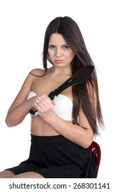 Pretty young woman with big machete knife, isolated