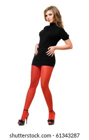 Pretty young woman in a black dress and red tights