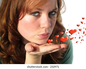 Pretty young woman blowing a kiss with a swirl of hearts on white background
