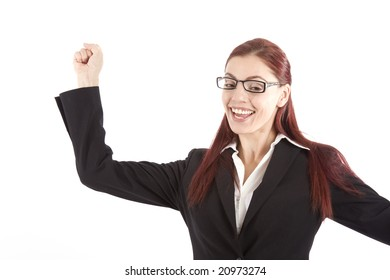 Pretty young woman in business attire raising her arm in celebration