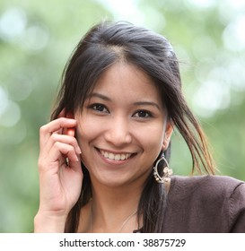 Pretty young woman calling on her cell phone