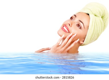 Pretty young woman in clean blue water