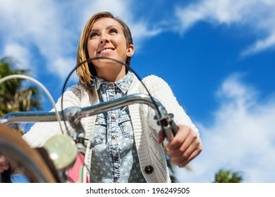 pretty young woman cycling in the park