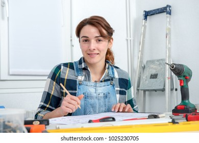 pretty young woman doing DIY work at her home