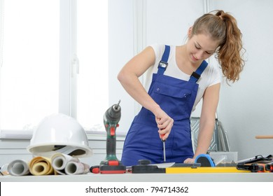 pretty young woman doing DIY work at home