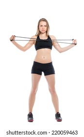 Pretty young woman doing exercises with expander. Isolated on white