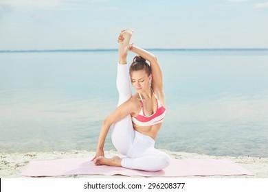 Pretty young woman doing yoga exercise for balance