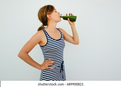 Pretty Young Woman Drinking Fresh Green Juice