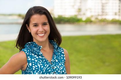 Pretty young woman enjoying the beach.