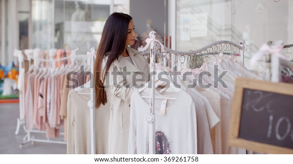 Pretty young woman in a fashion boutique