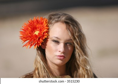Pretty young woman with flower on her hair