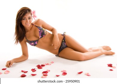 pretty young woman with flower petals