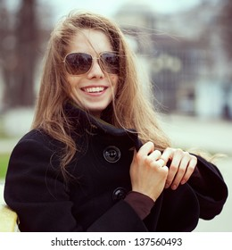 Pretty young woman in glasses smiles fun