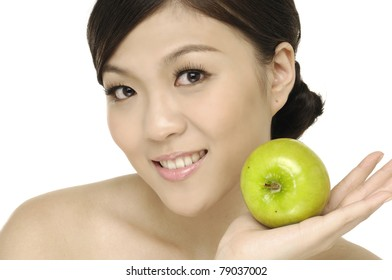 Pretty young woman with green apple isolated