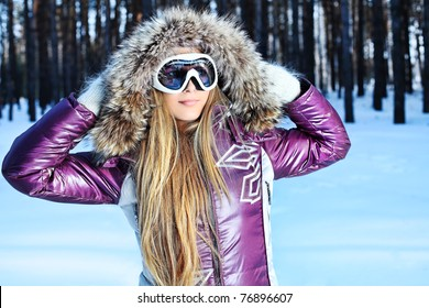 Pretty young woman having winter rest outdoor.