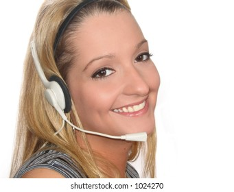 Pretty young woman with headset; isolated on white