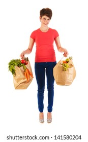 Pretty young woman with heavy bags healthy vegetables and fruit isolated over white background
