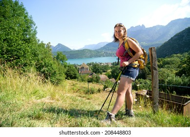 pretty young woman is hiking in the French Alps