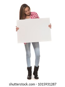 Pretty young woman holding empty blank board isolated on the white background