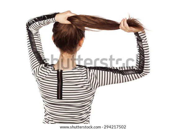 pretty young woman holding her hair with her hands