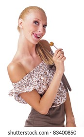 Pretty young woman holding lollipop
