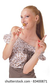 Pretty young woman holding lollipop smiling