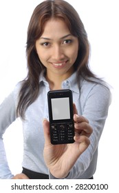A pretty young woman holds up a handphone
