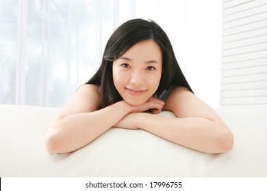 Pretty Young Woman at Home