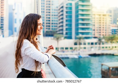 Pretty young woman looking from the bridge in Dubai