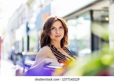 Pretty young woman looking at camera